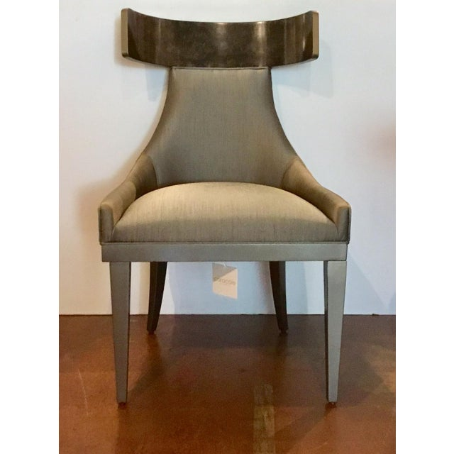 Original Retail $4880, stylish Caracole Modern Sitting in Style Dining Chairs Set of Four, wood frames finished in Harvest...