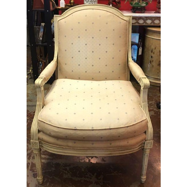 Louis XVI style open arm chair made by Baker Furniture with Scalamandre upholstery. Fauteuil (open arm armchair) has hand...