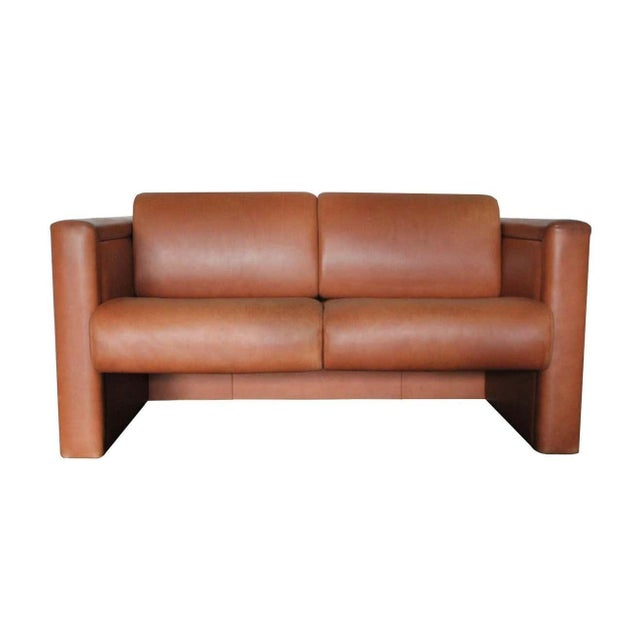 This iconic modern-design of peerless quality is a 2-seat lounge seating sofa designed by Trix and Robert Haussmann and...