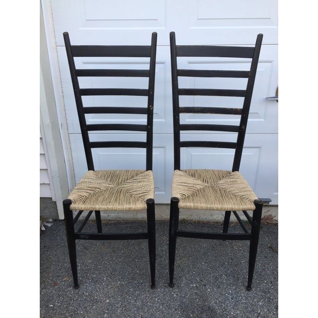 Set of 2 Italian ladderback chairs featuring a whimsical shape and traditional roots. Lightweight yet sturdy, all...