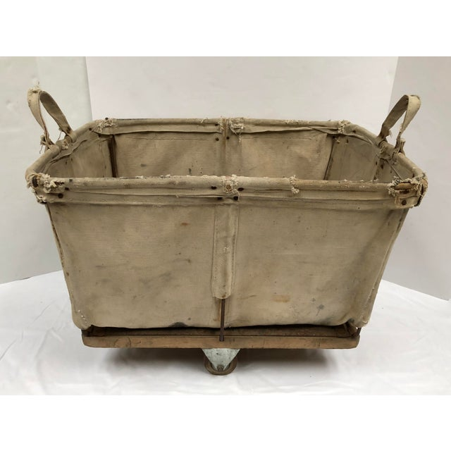 Industrial canvas cart. Originally used for a commercial laundry or postal service. Heavy-duty vintage wood wheels. Wood...