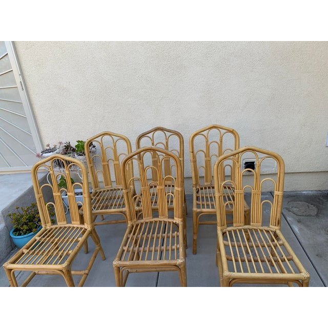 Gorgeous honey toned set of vintage bamboo and rattan set of six chairs. Arched woven design, solid and in fantastic...