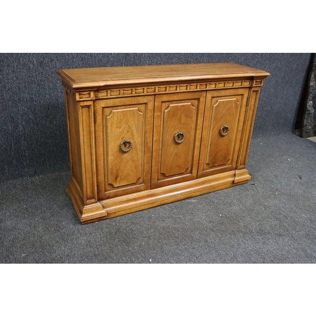 Italian style credenza. Made of Fruitwood, 2 raised panel doors , shelf inside brass ring pulls