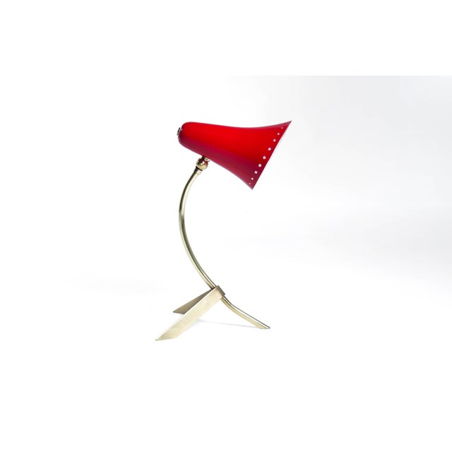 Petite table manufactured in Italy, circa 1950s. Red enameled shade in mint condition, brass newly polished, rewired.