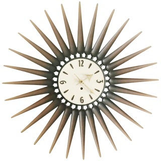 Danish Style Syroco Wood Sunburst Clock, Circa 1950 For Sale