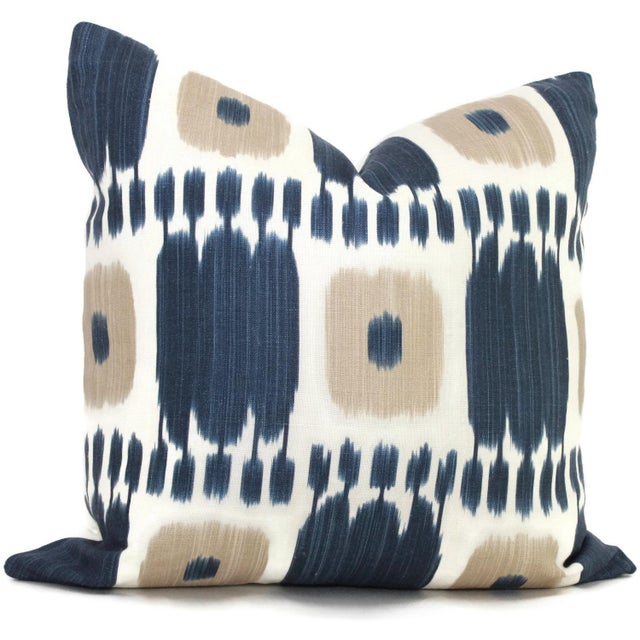 Add a pop o' blue to your decor with this striking blue and tan ikat pillow cover by Schumacher. It is a classic look that...
