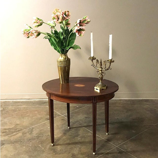 Antique French Mahogany Directoire Inlaid End Table features the tailored lines that make this style so popular for any...