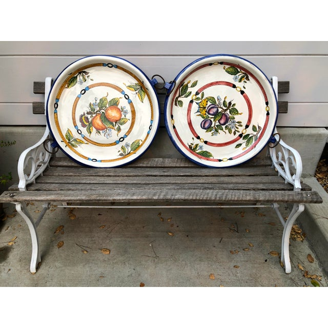 Large pair of luxurious, hand-crafted Italian ceramic decorative plates/ chargers. Multi-colored glazes produce vibrant...