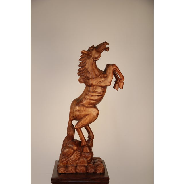 Nicely hand carved horse with good proportions and detail, made from solid mahogany.