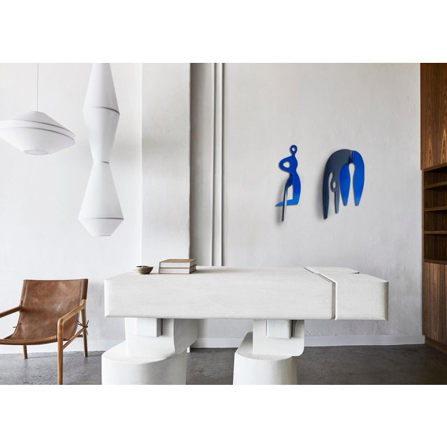 Both pieces. Navy and cobalt blue powder coated stainless steel wall sculpture. All hardware included. A semi-abstract...