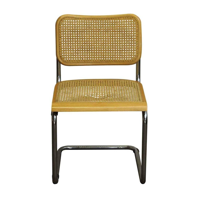 Vintage chair from the 1960s made of a light stained wood, woven cane, and a tubular chrome steel base. Fashioned in the...