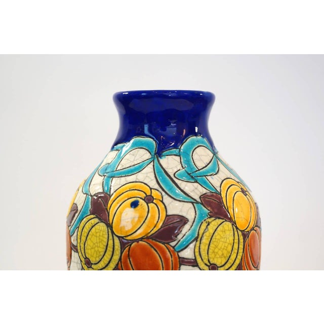 """Charles Catteau vase for Boch Freres La Louviere. """"Polychrome design with stylized gourd-like fruit, leaves, twigs and..."""