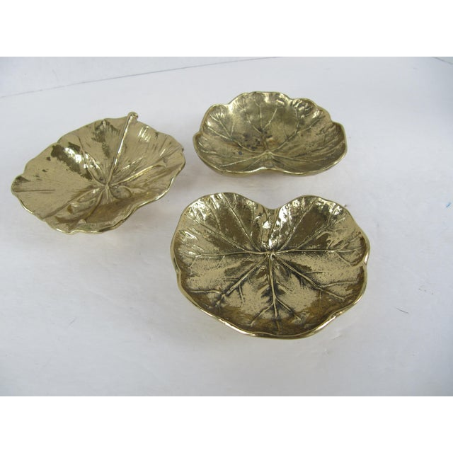 Three vintage brass Virginia Metal Crafter catchalls, two are geranium leaves and one in a ginkgo. These little piece...