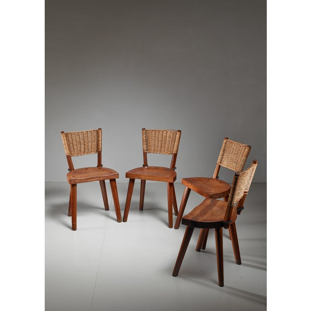 A very rare set of four chairs by Atelier Marolles, under the direction of and designed by Jean Touret. The chairs are...