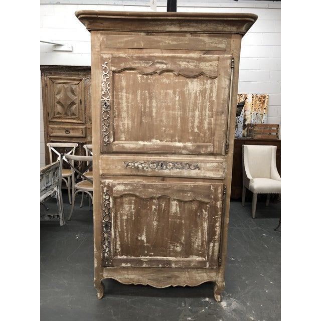 Gorgeous walnut French Louis XV provincial bonnetiere in a stripped gray finish. Two doors with shelves and one drawer...