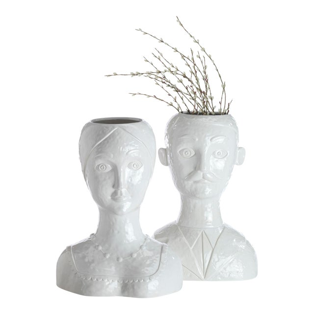 Launch a thousand conversations with this all white ceramic head vase. Great with flowers or fruit. Try is for your next...