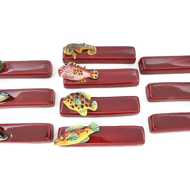 Set of ten French majolica knife rests with mixed figural fish. No maker's mark. Light wear.