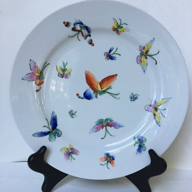 Lovely, decorative plate with all over colorful butterflies on a clean, white porcelain background. This hand painted...