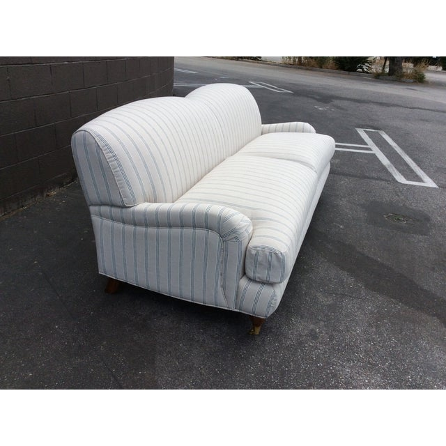 A beautiful English Club Sofa upholstered in a heavy Ralph Lauren linen. The color is tan with a dark gray stripe pattern....