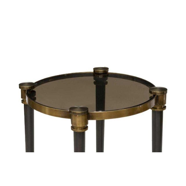 "New Uttermost Company ""Thora"" accent table, with smoke glass inset top, rising on brushed black tapered legs, accented..."