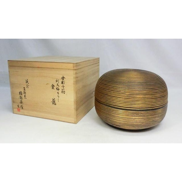 An Antique Japanese Ceramic lidded dome shaped vessel. Heavy and substantial. It makes a presence. Open the lid and the...