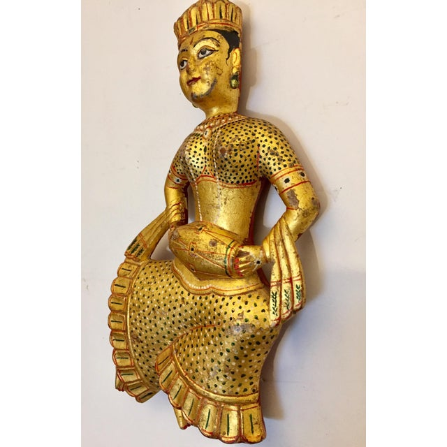 Set of two vintage Indian carved wood gilded sculptures. Hand carved and painted Rajasthani wooden figures depicting...