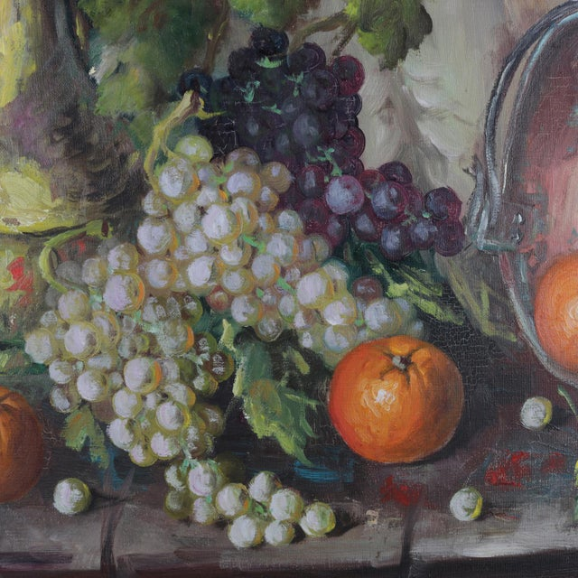A vintage Spanish oil on canvas still life painting by V. Lazaro representing fruit and wine, signed lower left, seated in...