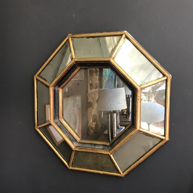 Vintage octagonal gilded mirror. Mirror is antique and shows age similar to mercury glass adding to the charm. Close up do...