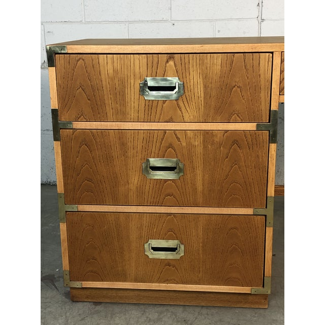 1970s Dixie Oak Wood Campaign & Bamboo Style Desk. The desk is in fully restored condition with brass pulls and four...