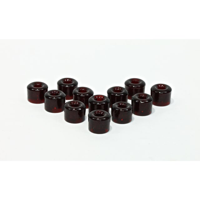 Here is a really nice set of 12 Blenko-style Ruby red glass mini taper holders. Very nice to accent a minimal holiday...