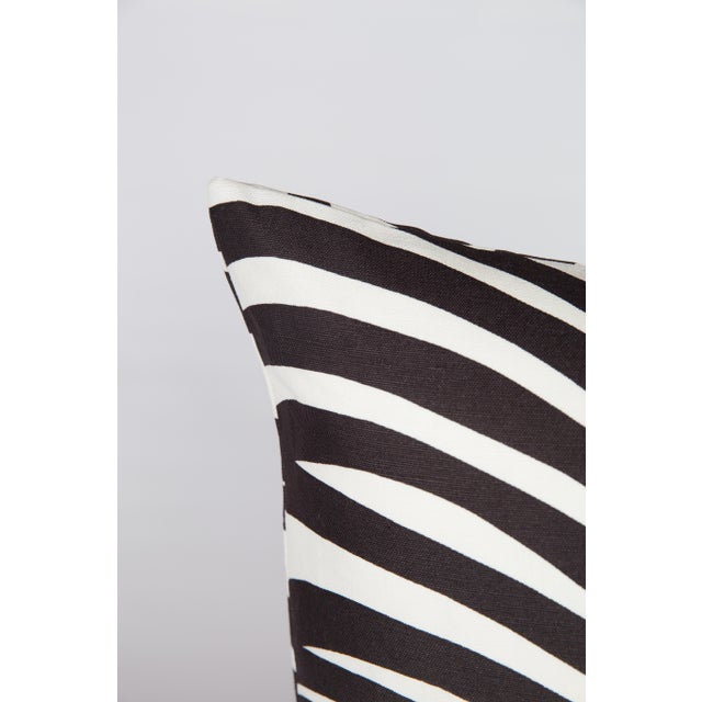 Pair of black-and-ivory pillows made from Schumacher's Zebra Palm pattern fabric. Patterns on fronts with coordinating...