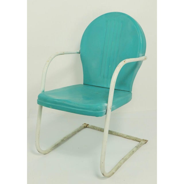 Offered in this lot are 2 matching Mid Century metal lawn chairs by Shott, in later blue paint finish. The chairs have...