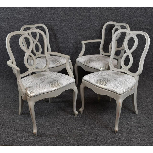 This Set includes two Arm Chairs and Two Side Chairs. And they have been lightly distressed. Gorgeous Chairs in Great...