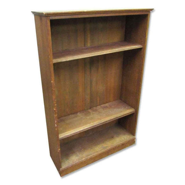 This is a three level wooden bookcase in restorable condition. The top and bottom shelves are small with a much larger...