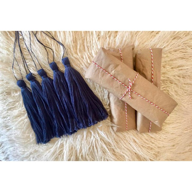 Our navy blue 'lagos' cotton tassel door hanger is handmade & dyed individually, making each a unique piece of door candy!...