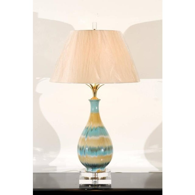 A stunning pair of drip glaze ceramic vessels as custom lamps. Fabulous scale, form and range of color. Lovely solid brass...