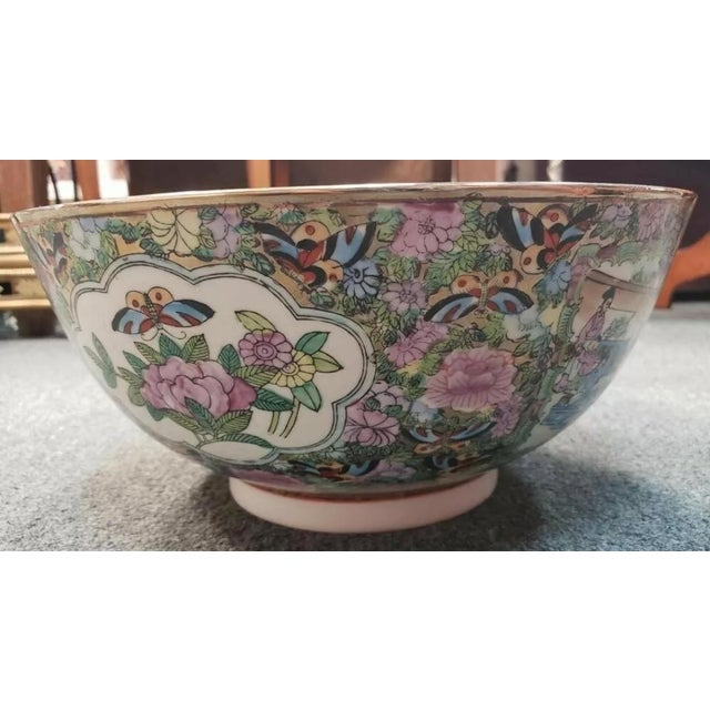Up for sale is a Mid 20th Century Chinese Rose Medallion Porcelain Punch Bowl with Imperial Court, Floral, and Butterfly...