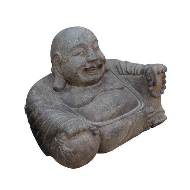 This is a small sitting Chinese Happy Buddha figure carved from grayish brown color stone. It is a nice piece for Zen...