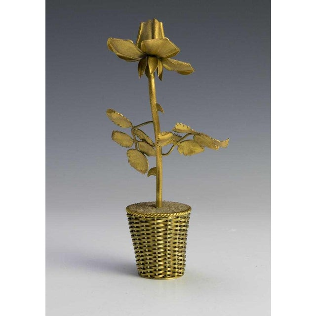 """Rose flower on a stem with gold washing over sterling in a quartz-crushed filled basket. The base stamped """"Tiffany & Co"""" ,..."""