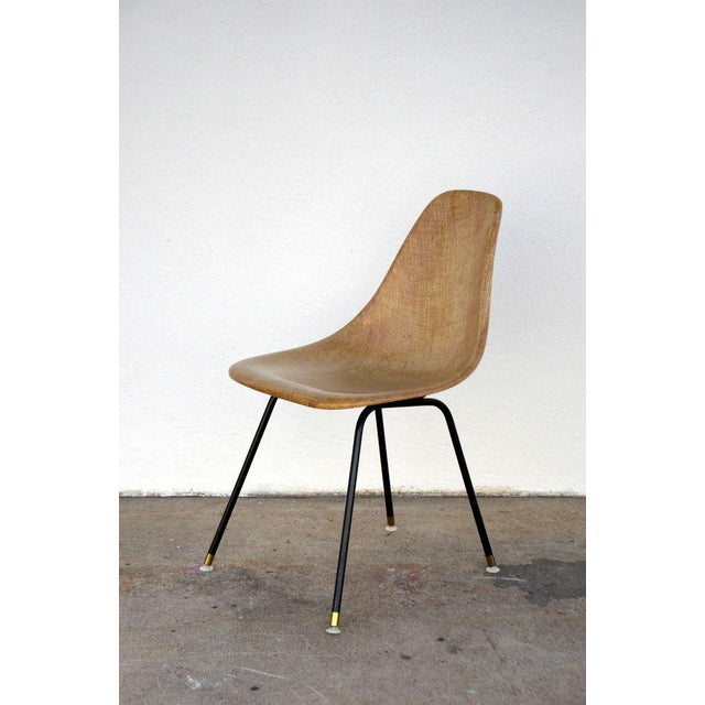 Single fiberglass encasted fabric mesh chair by Eames for Herman Miller. Great for a desk or a side chair.