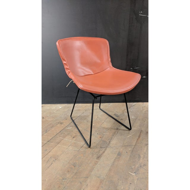 This original pre-1986 Bertoia Side Chair showcases the lightness and transparency of wire form design. This particular...
