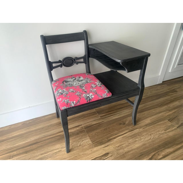 Vintage mid-century telephone or gossip table painted in a dark grey. The table features a small desk surface and storage...
