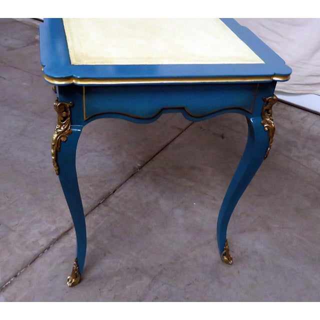 Louis XV style laquered leather top Cartonnier desk with gilt accents. The top contains 2 doors with 2 shelves and 2...