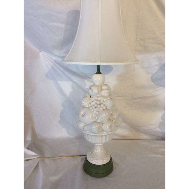 Dating from the 1950's, these white lamps are in the shape of a basket piled high with fruit, lending a whimsical but...