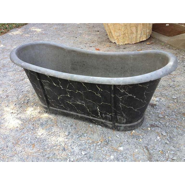 French zinc tub with faux marbled exterior.