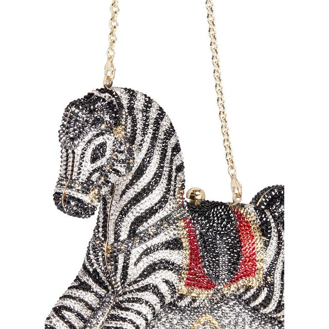 Turning childhood memories into collectible pieces, Judith Leiber designed this minaudière with a Rocking Horse design...