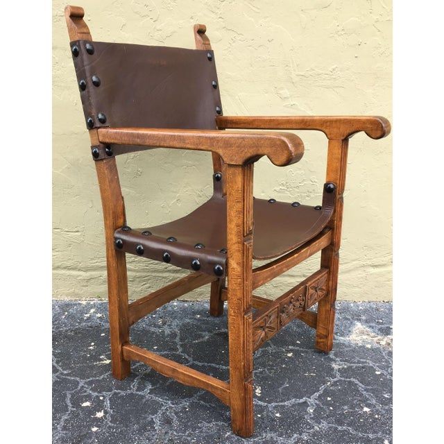 About Renaissance style armchair from the Catalan region of Spain. Constructed from richly stained oak and leather,...