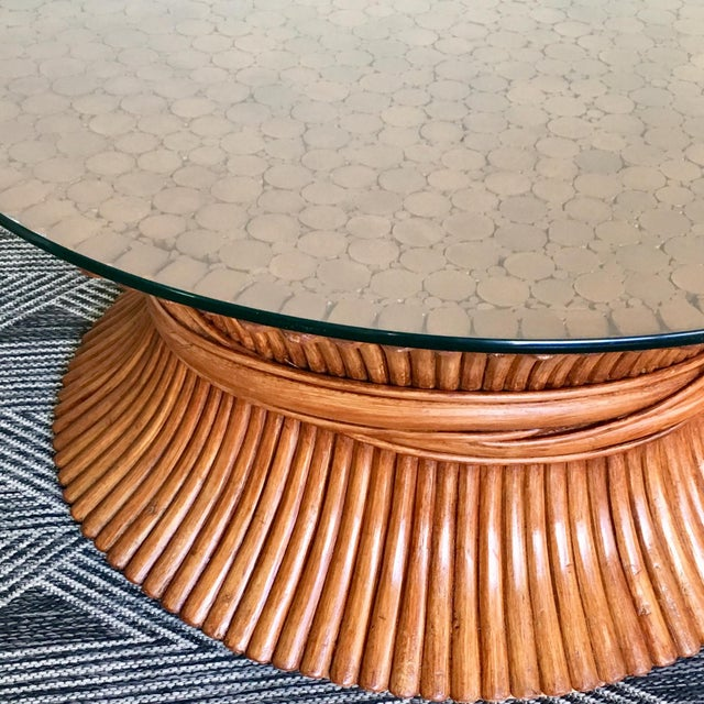 Exemplary McGuire lacquered bamboo round coffee table. One of the finer examples of this iconic mid-century piece,...