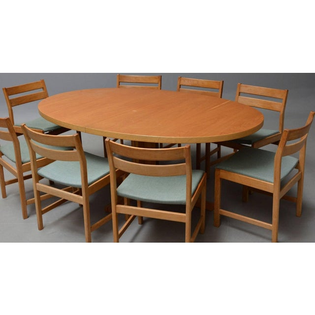 Set of eight chairs with corresponding table by Kurt Stervig for KP Furniture. Dining table with two additional plates and...
