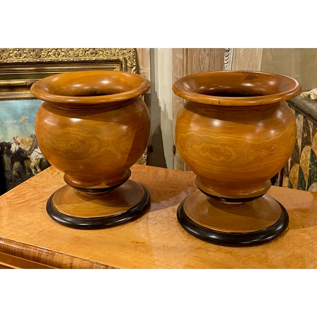 Turned wood footed bowl with so many uses such as a center bowl, fill with florals or fruits but just as pretty sitting on...